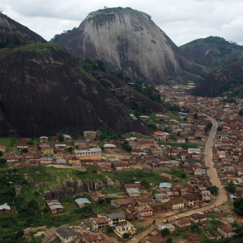 Visit Nigeria. Local town and mountain.