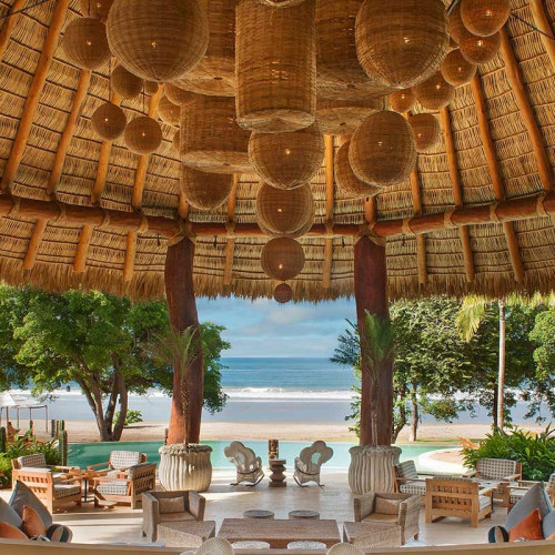 Bastketry lanterns and outdoors seating with beach views at Mukul Resort, Nicaragua