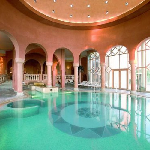 Spectacular pool at the Residence Tunis with terracotta columns and turquoise water