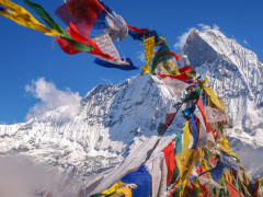 Tibetan Flags at Annapurna Base Camp Nepal Heli-Biking in the himalayas under Mt. Everest