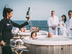 Guests enjoying Champagne at the Most Exclusive Private Island in England