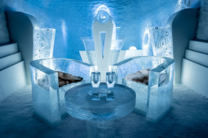 Ice booth with table and seating with ice sculptures at the Ice Hotel, Swede