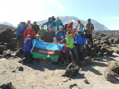 group of people climbing mount kilimanjaro trek