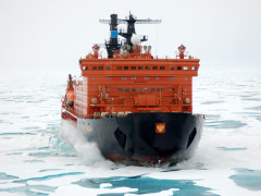 Sea vessel breaking through the ice on route to destination