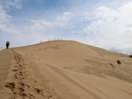 People trekking across desert in Kazakstan