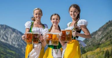 Ladies holding beer at Oktoberfest