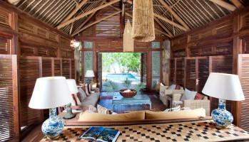 tribal africa themed luxury interior of beach bungalow on vamizi island paradise