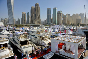 Yachts moored up front of Dubai cityscape for the International Boat Show
