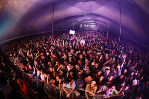 Crowds dancing in a tent to music at Splashy Fen