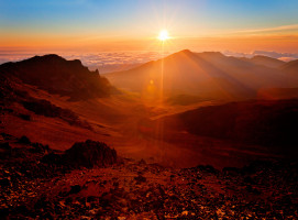 Colourful sunrise behind mountain range at haleakala