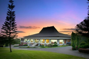 merapi golf resort clubhouse at sunset