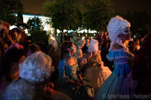 Guests in Parisian masquerade clothing enjoying the night at the Grand Masked Ball, Palace of Versailles