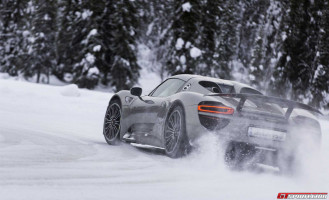porsche driving in snowy forest kicking up snow