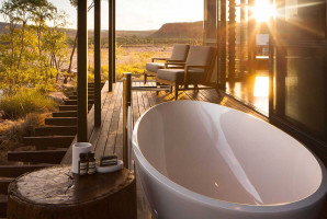 bath on the decking outside private bungalow in the australian bush at El Questro Homestead