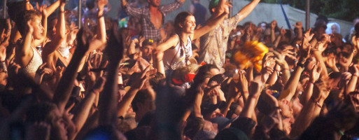 Crowds dancing in the evening light at Byron Bay Bluesfest