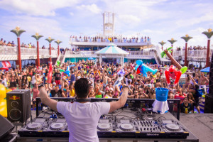 DJ playing to the crowd aboard Anchored Party Cruise