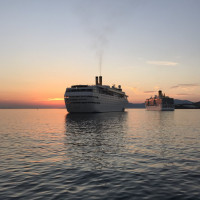 Anchored Party Cruise ship at sunset