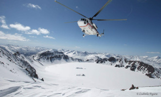 heli-skiing helicopter over snowy mountains in Kamchatka