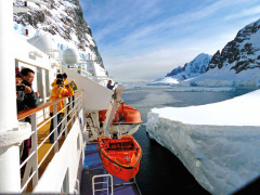Passengers view in amazement from their sea vessel