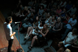 Reader on stage at The Moth StorySLAM