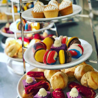 Afternoon tea of brightly coloured cakes and macaroons