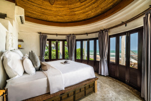 round walled bedroom with endless windows with ocean view at Aleenta Hua Hin