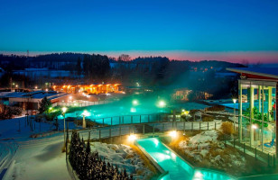 Aqua Dome Thermal Spa Hotel, Tirol at night with lit up pools and walkways