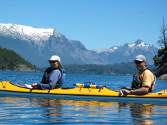 Couple Kayaking on an Argentina Mountains and Wineries Tour