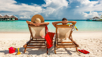 romantic couple relax on beach chair on a Tour of Sri Lanka and the Maldives